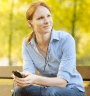 woman listening to audio on her phone
